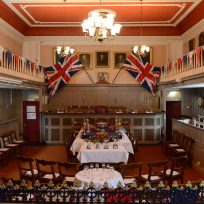 Guildhall Main Chamber set up for a Mayor Making Ceremony with bunting and flags and the town silver.
