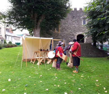 St Anne's building in the background with a Civil War living history camp on the grass area in front.
